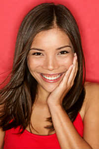 Latin Woman with Red Background - Smiling - MAIN PAGE - Crop - Blog - Sm