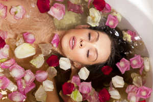 Woman in Bath with Red and Pink Flower Petals - MAIN PAGE - Crop - Blog - Sm
