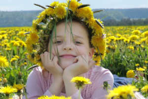 Young girl in yellow flower field - SPLENDOR IN THE LEMONGRASS - Crop - Blog - Sm